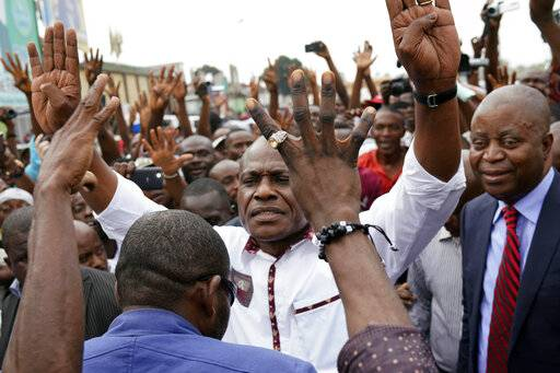 "Spurned Congo opposition candidate Martin Fayulu greets supporters as he arrives at a rally in Kinshasha, Congo, Friday, Jan. 11, 2019. Hundreds gathered to denounce what they called ""the people's stolen victory"" in the presidential election."