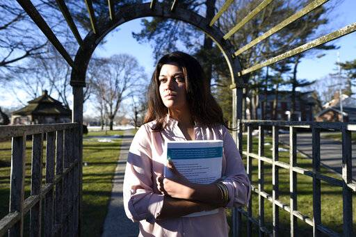 "FILE - In this Feb. 2, 2016, file photo, Naila Amin, 26, holds a book from one of the classes she was taking at Nassau Community College in Garden City, N.Y. According to data provided to The Associated Press, the U.S. approved thousands of requests by men to bring child and teenage brides from another country. ""My passport ruined my life,� said Naila Amin, a dual citizen from Pakistan who grew up in New York City. She was forcibly married at 13 in Pakistan and applied for papers for her 26-year-old husband to come to the country. ""People die to come to America. I was a passport to him. They all wanted him here, and that was the way to do it.�"