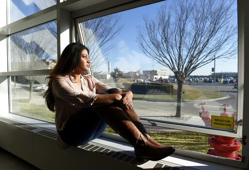 "FILE - In this Feb. 2, 2016, file photo, Naila Amin, 26, looks out from a classroom window at Nassau Community College in Garden City, N.Y. According to data provided to The Associated Press, the U.S. approved thousands of requests by men to bring child and teenage brides from another country. ""My passport ruined my life,� said Naila Amin, a dual citizen from Pakistan who grew up in New York City. She was forcibly married at 13 in Pakistan and applied for papers for her 26-year-old husband to come to the country. ""People die to come to America. I was a passport to him. They all wanted him here, and that was the way to do it.�"