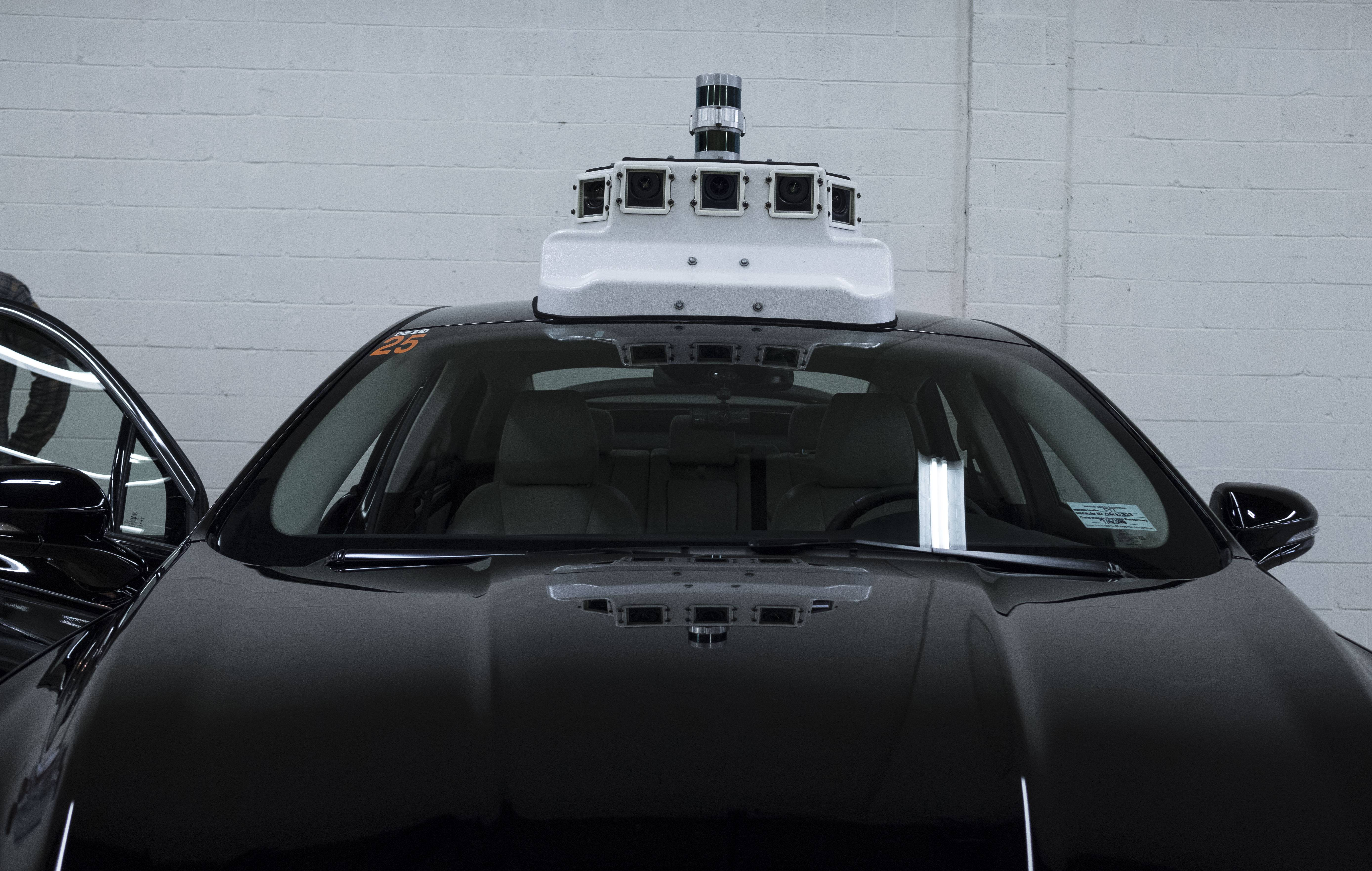 A Ford vehicle that will eventually be made into a self-driving car is outfitted with cameras at the Ford terminal in Washington, D.C.