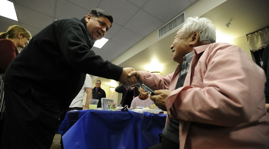 Gov.-Elect J.B. Pritzker greets the residents of the Lutheran Social Services of Illinois Senior Apartments in Aurora on Saturday.
