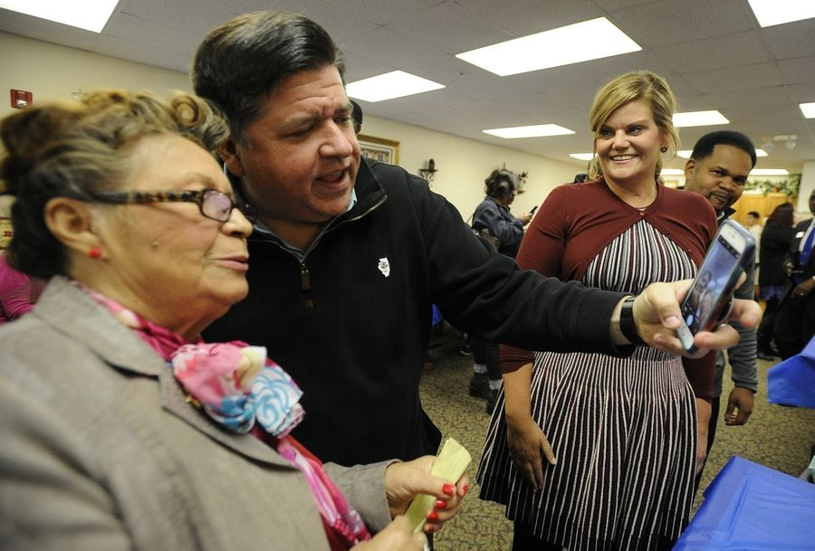 Gov.-Elect J.B. Pritzker and his wife, M.K., along with Aurora Mayor Richard Irvin, greet the residents of the Lutheran Social Services of Illinois Senior Apartments on Saturday, including Eloisa Lopez.