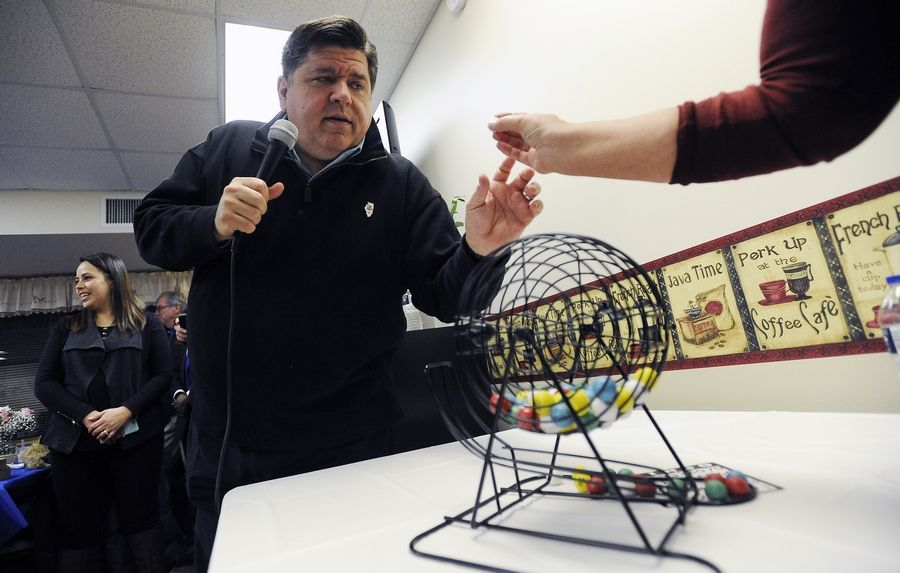 Gov.-Elect J.B. Pritzker calls a mean game of bingo Saturday for the residents of the Lutheran Social Services of Illinois Senior Apartments in Aurora.