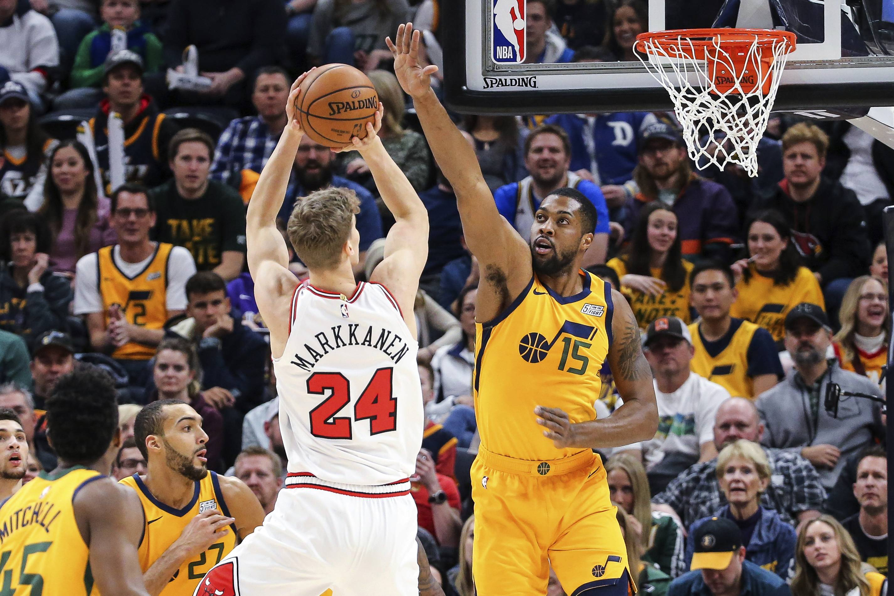 Chicago Bulls forward Lauri Markkanen (24) shoots over Utah Jazz forward Derrick Favors (15) during the first quarter of an NBA basketball game Saturday, Jan. 12, 2019, in Salt Lake City.