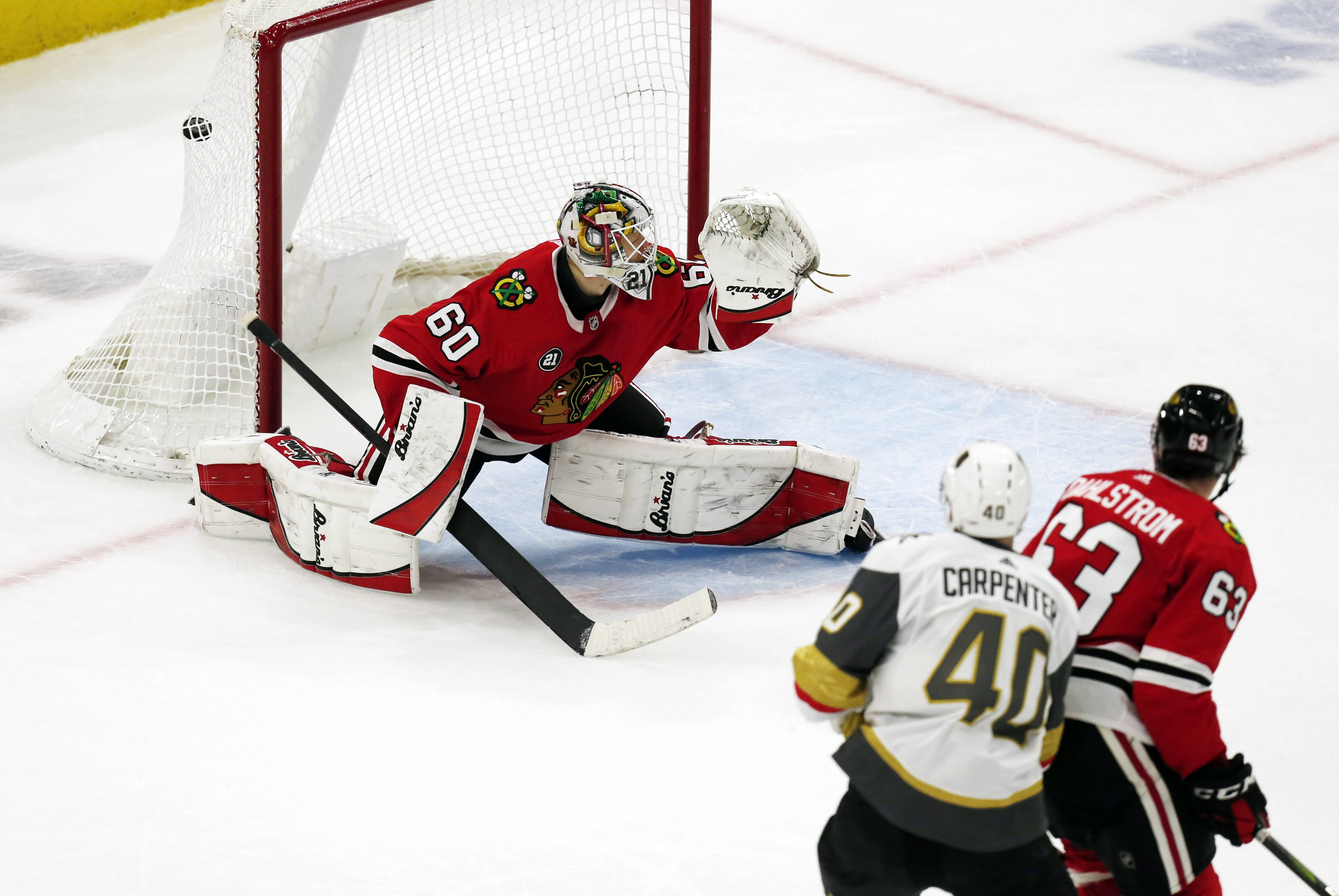 Vegas Golden Knights center Ryan Carpenter (40) scores a goal past Chicago Blackhawks goaltender Collin Delia (60) during the second period of an NHL hockey game Saturday, Jan. 12, 2019, in Chicago.