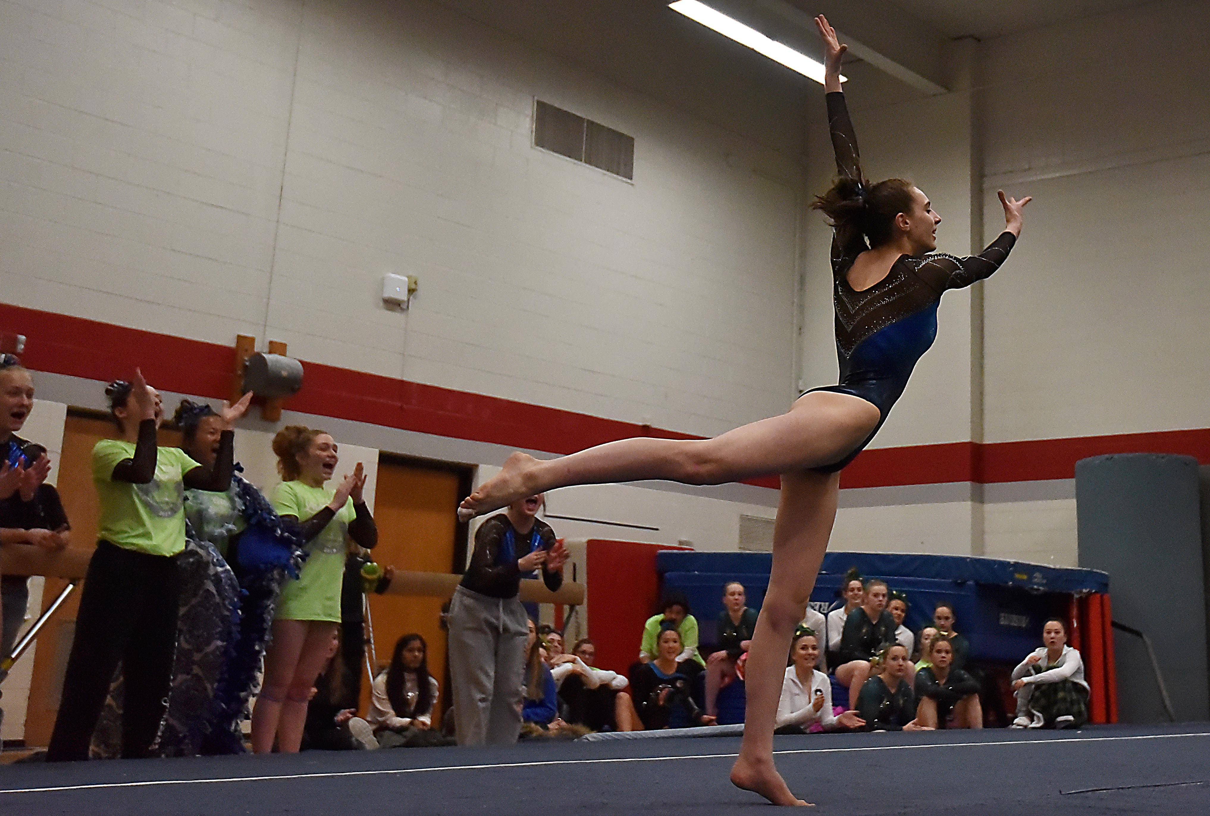 Lake Zurich's Carly Trebac performs the Floor Exercise at the Lake County girls gymnastics meet Saturday.