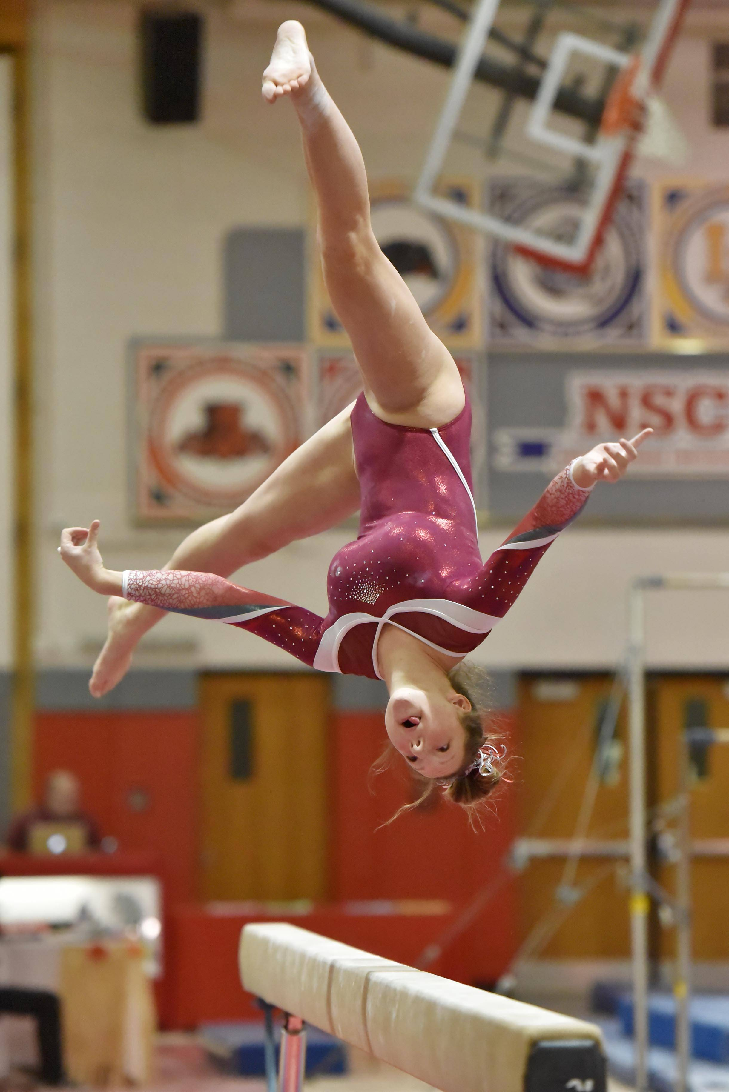 Mundelein's Elle Mishler performs on the Balance Beam at the Lake County girls gymnastics meet Saturday at Mundelein High School.