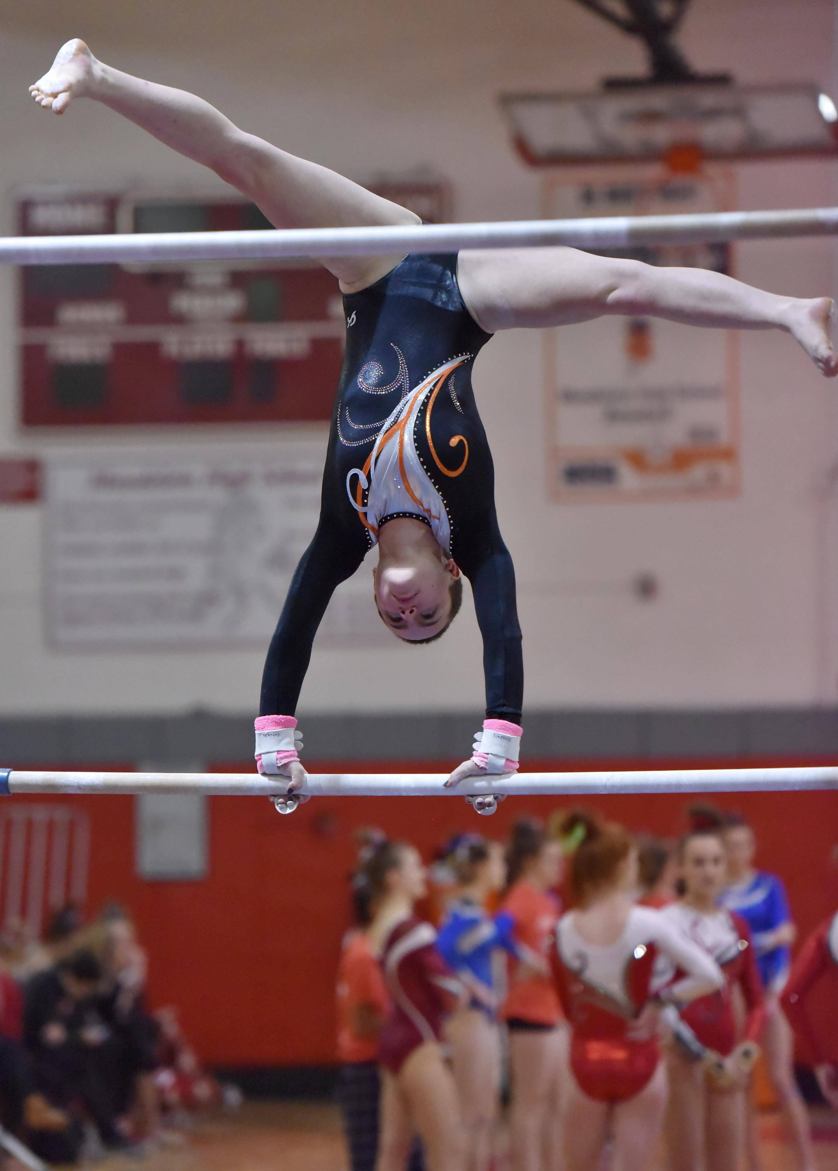 Libertyville's Liv Bertaud on the Uneven Bars at the Lake County girls gymnastics meet Saturday at Mundelein High School.