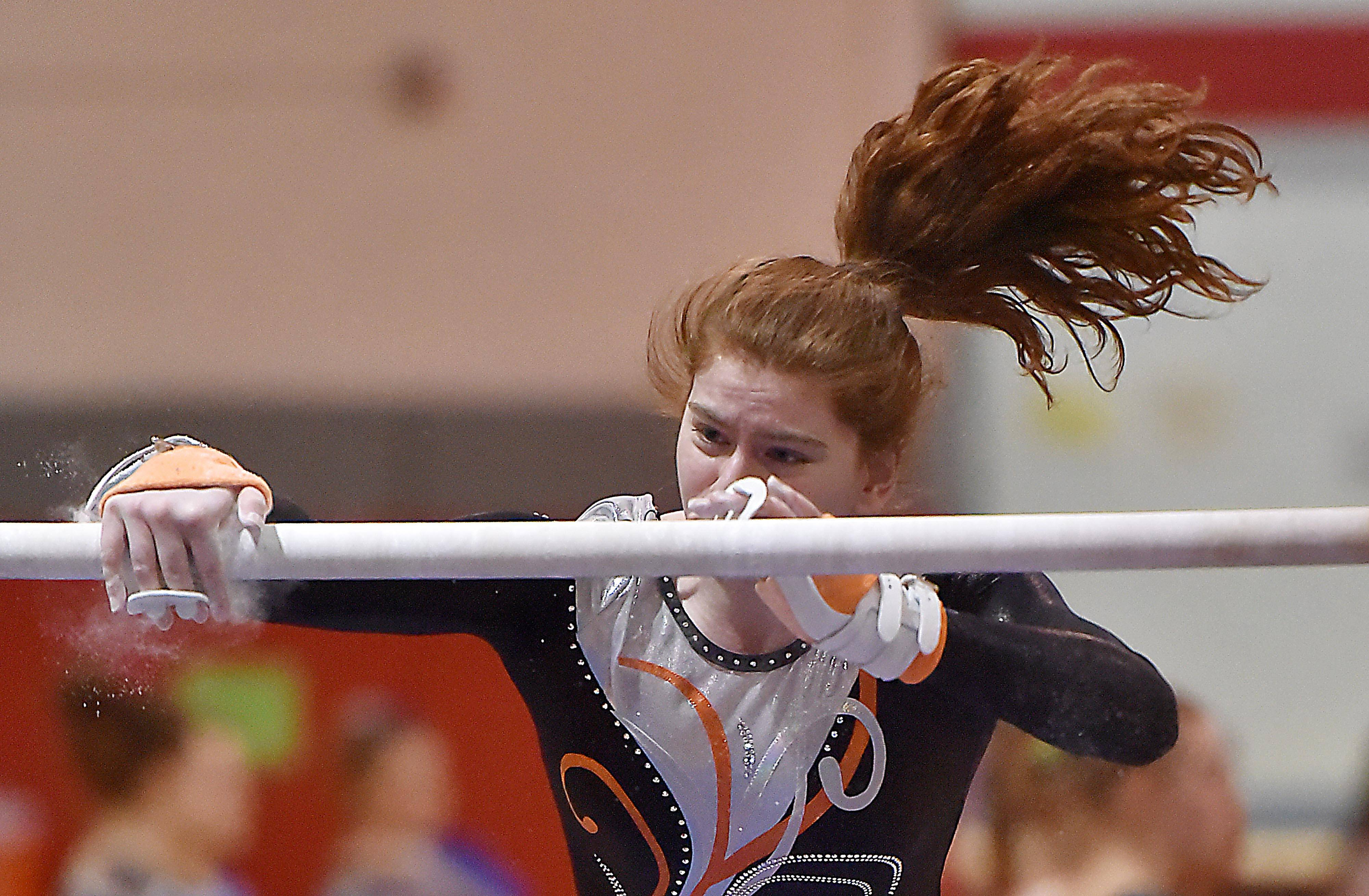 Libertyville's Constance Zanze on the Uneven Bars at the Lake County girls gymnastics meet Saturday at Mundelein High School.