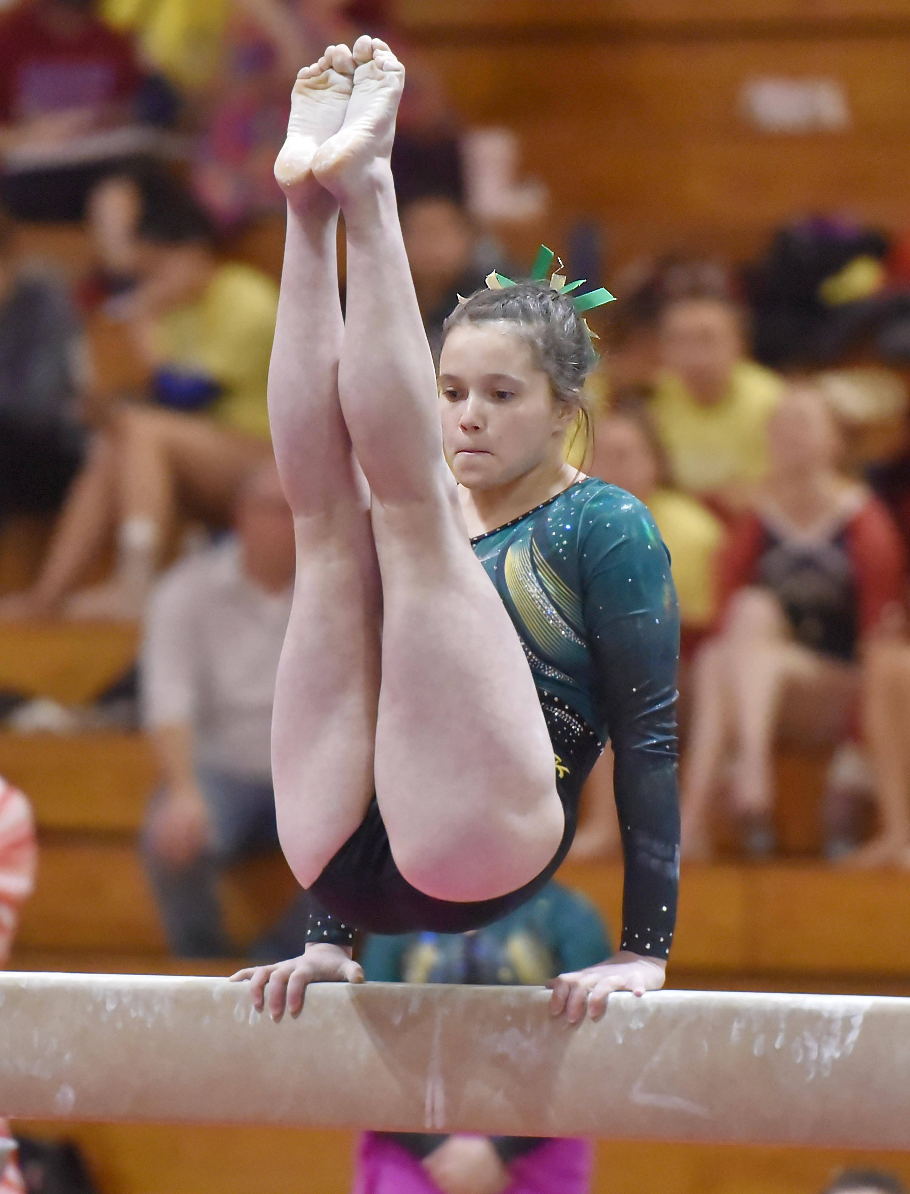 Stevenson's Emily Weinstein performs on the Balance Beam at the Lake County girls gymnastics meet Saturday at Mundelein High School.