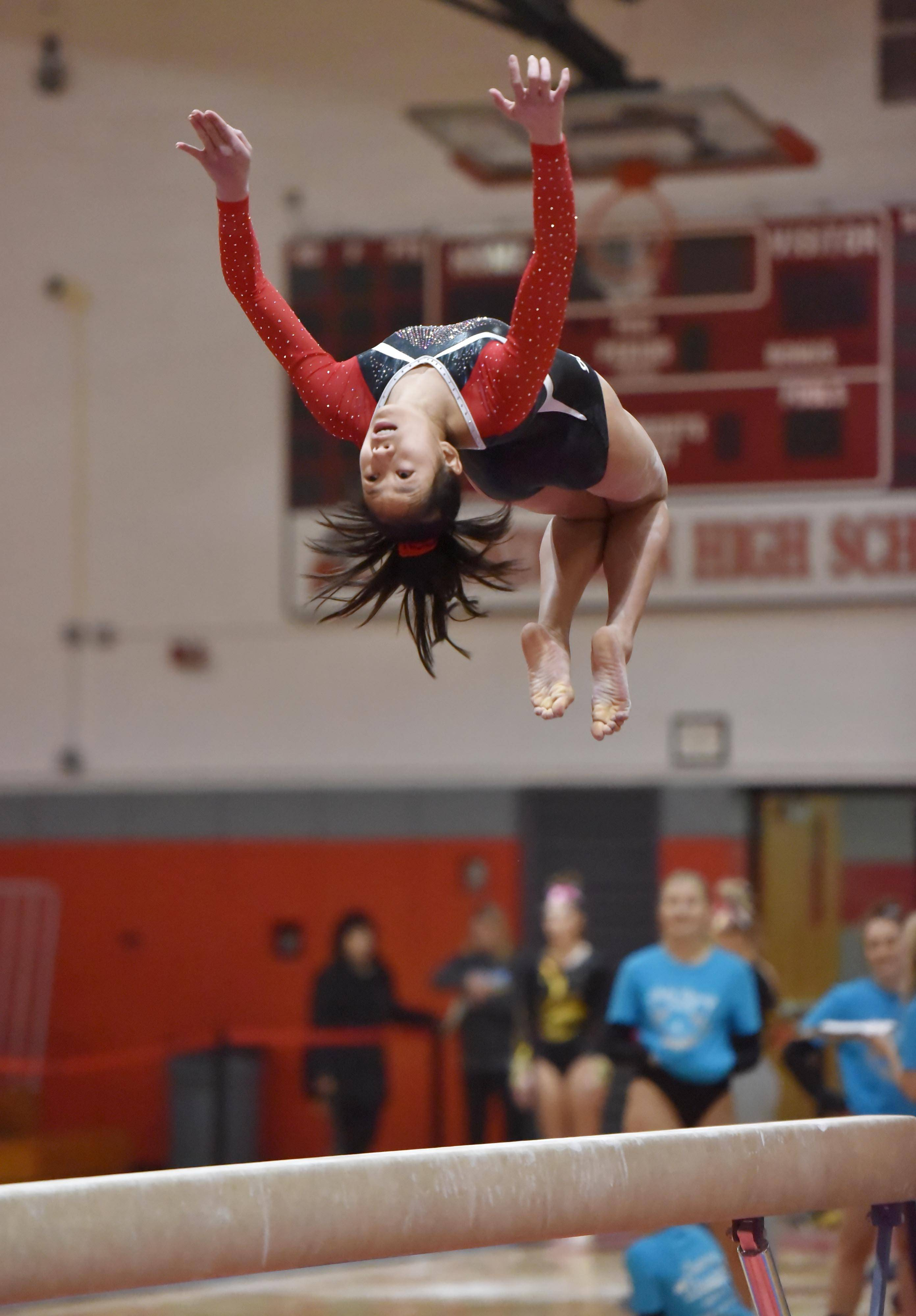 Barrington's Jade Moranetz performs on the Balance Beam at the Lake County girls gymnastics meet Saturday at Mundelein High School.