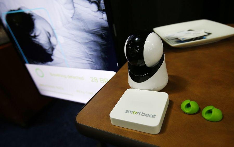 Smartbeat displays a internet connected camera that measures a baby's breathing rate and will send an alert to parents if any problems are detected, at the CES Unveiled at CES International Sunday, Jan. 6, 2019, in Las Vegas.
