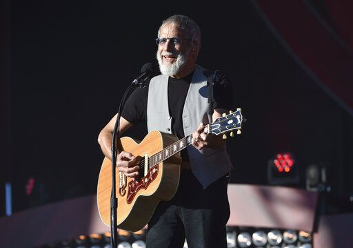 FILE - In this Saturday, Sept. 24, 2016, file photo, musician Yusuf Cat Stevens performs at the 2016 Global Citizen Festival in Central Park in New York. Missy Elliott is making history as the first female rapper inducted into the Songwriters Hall of Fame, whose 2019 class also includes legendary British singer Stevens and country-folk icon John Prine and others announced Saturday, Jan. 12, 2019, by the organization. (Photo by Evan Agostini/Invision/AP, File)
