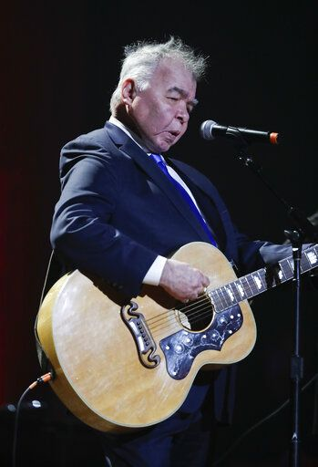 FILE - In this Wednesday, Sept. 13, 2017 file photo, John Prine performs during the Americana Honors and Awards show in Nashville, Tenn. Missy Elliott is making history as the first female rapper inducted into the Songwriters Hall of Fame, whose 2019 class also includes legendary British singer Cat Stevens and country-folk icon Prine and others announced Saturday, Jan. 12, 2019, by the organization.