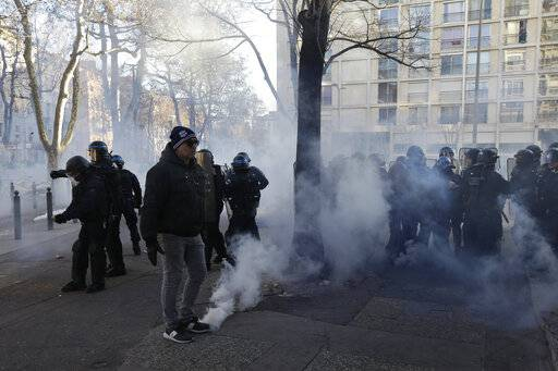 French police take positions during a yellow vest protest in Marseille, southern France, Saturday, Jan. 12, 2019. Paris brought in armored vehicles and the central French city of Bourges shuttered shops to brace for new yellow vest protests. The movement is seeking new arenas and new momentum for its weekly demonstrations. Authorities deployed 80,000 security forces nationwide for a ninth straight weekend of anti-government protests.