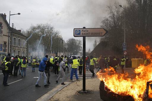 French police fires tear gas during a yellow vest demonstration in Bourges, central France, Saturday, Jan. 12, 2019. Paris brought in armored vehicles and the central French city of Bourges shuttered shops to brace for new yellow vest protests. The movement is seeking new arenas and new momentum for its weekly demonstrations. Authorities deployed 80,000 security forces nationwide for a ninth straight weekend of anti-government protests.