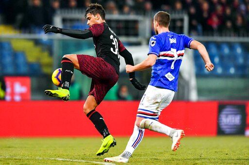 AC Milan midfielder Lucas Paqueta, left, and Sampdoria's defender Jacopo Sala vie for the ball during the Italian Cup soccer match between Sampdoria and Milan at the Luigi Ferraris stadium in Genoa, Italy, Saturday, Jan. 12, 2019. (Simone Arveda/ANSA via AP)