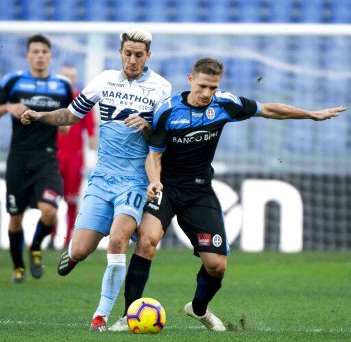 Lazio's Joaquin Correa, left, and Novara's Ronaldo vie for the ball during the Italian Cup soccer match between Lazio and Novara at the Olympic stadium in Rome, Saturday, Jan. 12, 2019. (Claudio Peri/ANSA via AP)