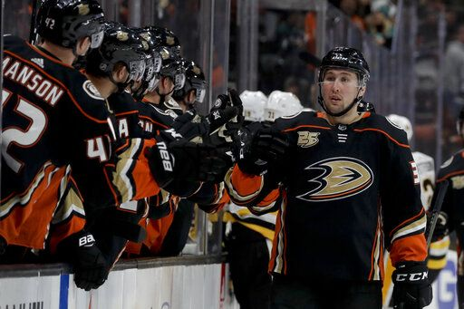 Anaheim Ducks left wing Nick Ritchie is congratulated after scoring against the Pittsburgh Penguins during the first period of an NHL hockey game in Anaheim, Calif., Friday, Jan. 11, 2019.