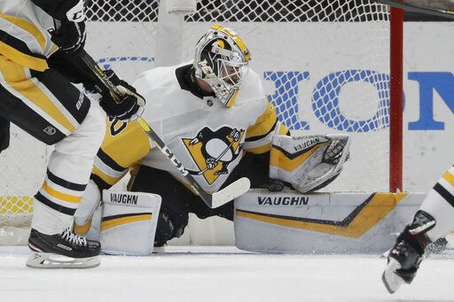 Pittsburgh Penguins goaltender Matt Murray blocks a shot during the first period of the team's NHL hockey game against the Anaheim Ducks in Anaheim, Calif., Friday, Jan. 11, 2019.