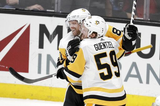 Pittsburgh Penguins left wing Jake Guentzel (59) celebrates his goal with right wing Phil Kessel during the second period of an NHL hockey game against the Anaheim Ducks in Anaheim, Calif., Friday, Jan. 11, 2019.