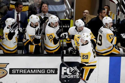 Pittsburgh Penguins left wing Jake Guentzel is congratulated after scoring against the Anaheim Ducks during the second period of an NHL hockey game in Anaheim, Calif., Friday, Jan. 11, 2019.