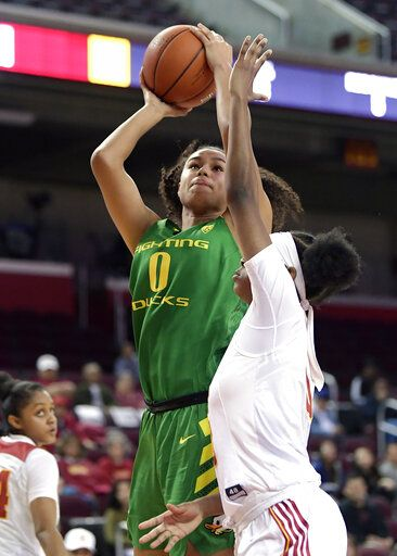 Oregon's Satou Sabally shoots as Southern California's Shalexxus Aaron defends during the first half of an NCAA college basketball game Friday, Jan. 11, 2019, in Los Angeles.