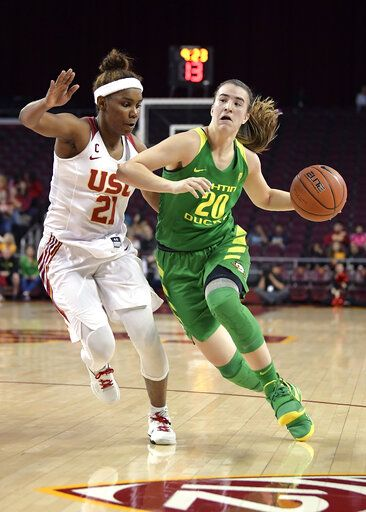 Oregon's Sabrina Ionescu, right, drives toward the basket as Southern California's Aliyah Mazyck defends during the first half of an NCAA college basketball game Friday, Jan. 11, 2019, in Los Angeles.