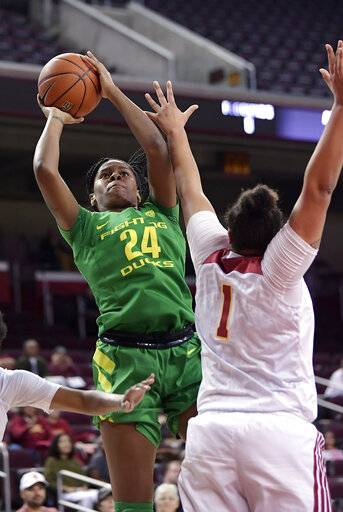 Oregon's Ruthy Hebard, left, shoots as Southern California's Kayla Overbeck defends during the first half of an NCAA college basketball game Friday, Jan. 11, 2019, in Los Angeles.