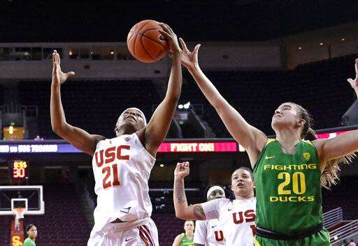 Southern California's Aliyah Mazyck, left, and Oregon's Sabrina Ionescu reach for a rebound during the second half of an NCAA college basketball game Friday, Jan. 11, 2019, in Los Angeles. Oregon won 93-53.
