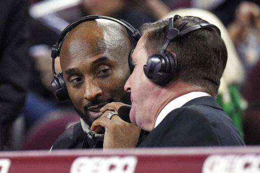 Former Los Angeles Laker Kobe Bryant, left, talks with sportscaster Jim Watson during the second half of an NCAA college basketball game between Oregon and Southern California on Friday, Jan. 11, 2019, in Los Angeles. Oregon won 93-53.
