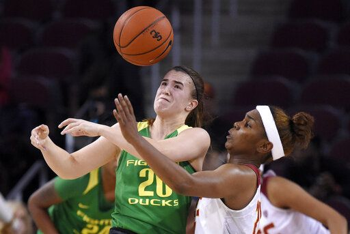 Southern California's Aliyah Mazyck, right, knocks the ball from the hands of Oregon's Sabrina Ionescu during the second half of an NCAA college basketball game Friday, Jan. 11, 2019, in Los Angeles. Oregon won 93-53.