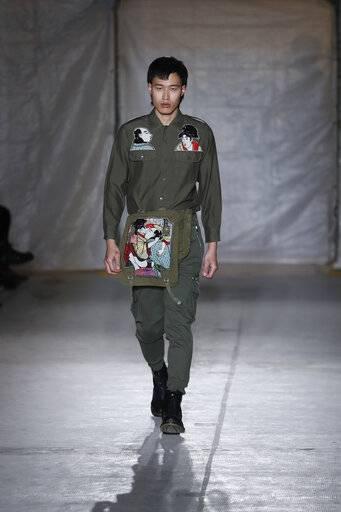 model winnie harlow wears a creation as part of the john richmond mens fall winter