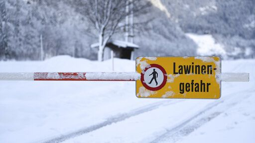 "A danger sign "" danger of avalanches"" displayed at a closed street in Weissbach near Lofer, Austrian province of Salzburg on Friday, Jan. 11, 2019."