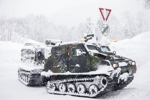 A track vehicle of the German army provides food to a village near Berchtesgaden, southern Germany, Thursday, Jan. 10, 2019 after southern Germany and Austria have been hit by heavy snowfall. (Bernd Maerz/dpa via AP)