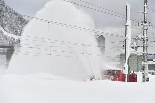 A railway cleans snow from the rails on Saturday, Jan. 12, 2019 in Hochfilzen, Austrian province of Tyrol.