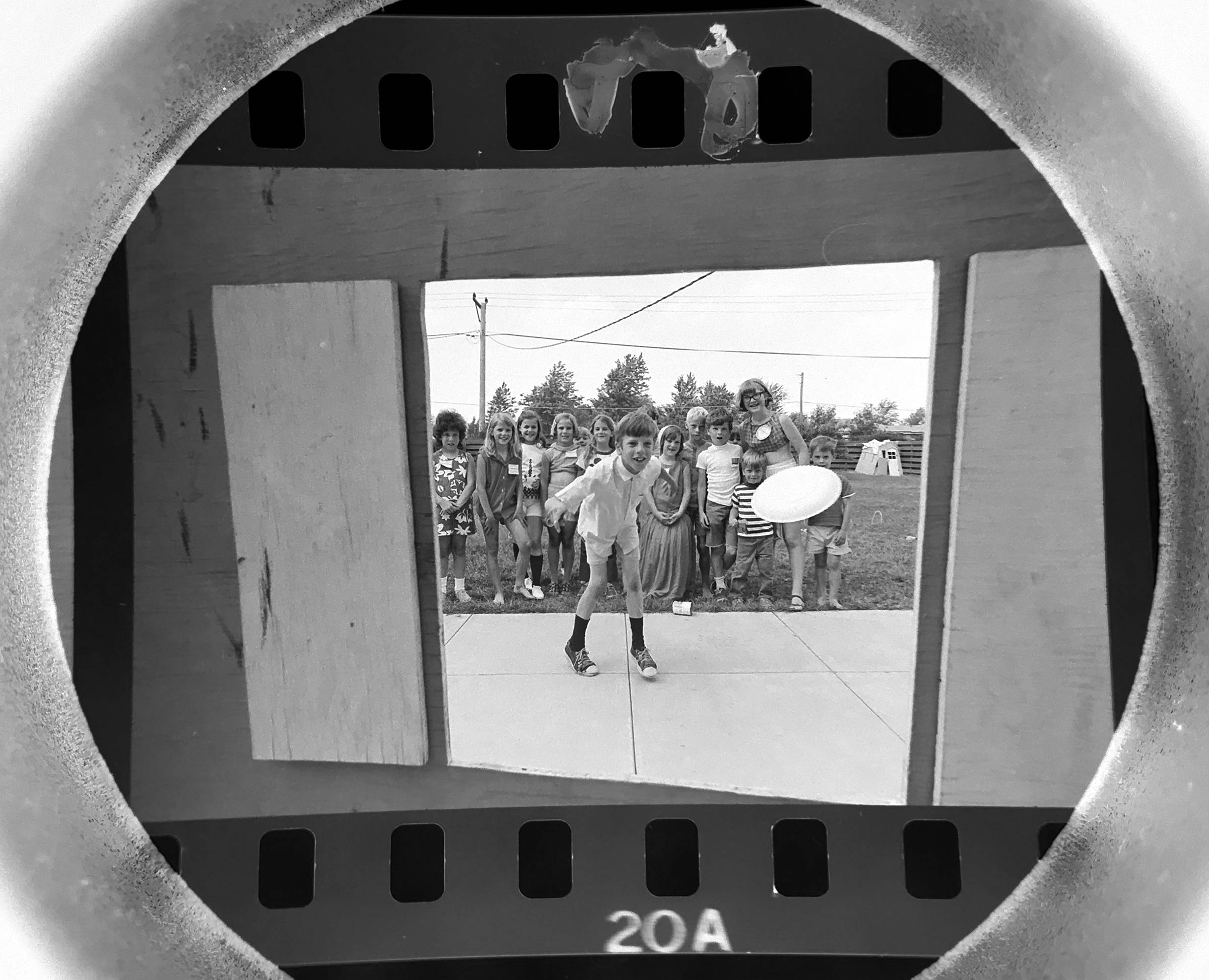 The Daily Herald Archives, Assignment 21,951, Jay Needleman photo: Ross Siragusa tosses a pie a during the pie toss at a neighborhood carnival in Des Plaines to help fight muscular dystrophy. The carnival raised $7.38 which was donated to the Muscular Dystrophy Association of America in June of 1971.