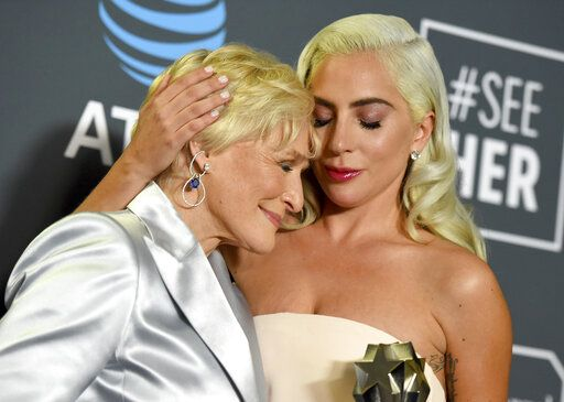 "Glenn Close, left, and Lady Gaga, winners in a tie for the best actress award, hug in the press room at the 24th annual Critics' Choice Awards on Sunday, Jan. 13, 2019, at the Barker Hangar in Santa Monica, Calif. Close won for her role in ""The Wife"" and Lady Gaga won for her role in ""A Star Is Born."" (Photo by Jordan Strauss/Invision/AP)"