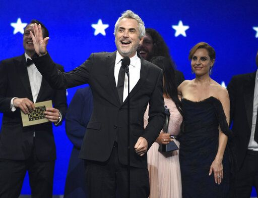 "Alfonso Cuaron accepts the award for best picture for ""Roma"" at the 24th annual Critics' Choice Awards on Sunday, Jan. 13, 2019, at the Barker Hangar in Santa Monica, Calif. (Photo by Chris Pizzello/Invision/AP)"