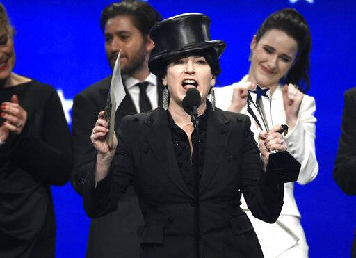 "Amy Sherman-Palladino accepts the award for best comedy series for ""The Marvelous Mrs. Maisel"" at the 24th annual Critics' Choice Awards on Sunday, Jan. 13, 2019, at the Barker Hangar in Santa Monica, Calif. (Photo by Chris Pizzello/Invision/AP)"