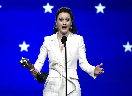 "Rachel Brosnahan accepts the award for best actress in a comedy series for ""The Marvelous Mrs. Maisel"" at the 24th annual Critics' Choice Awards on Sunday, Jan. 13, 2019, at the Barker Hangar in Santa Monica, Calif. (Photo by Chris Pizzello/Invision/AP)"