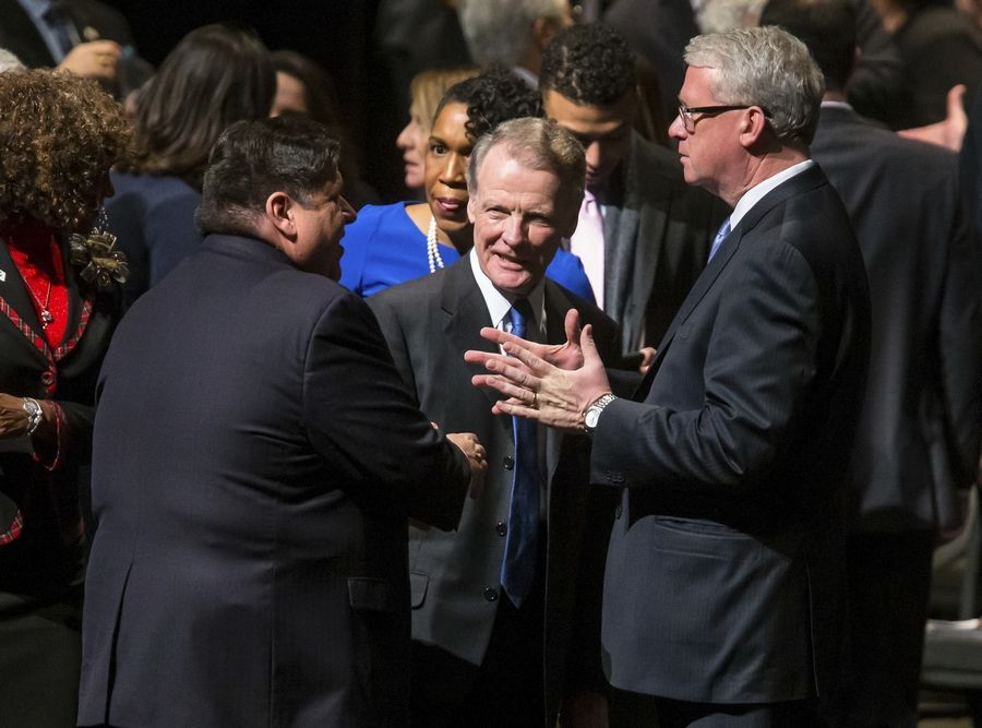 Illinois Speaker of the House Michael Madigan, center, visits with Illinois House Minority Leader Jim Durkin, right, and Illinois Gov. J.B. Pritzker before Pritzker's inauguration Monday in Springfield.