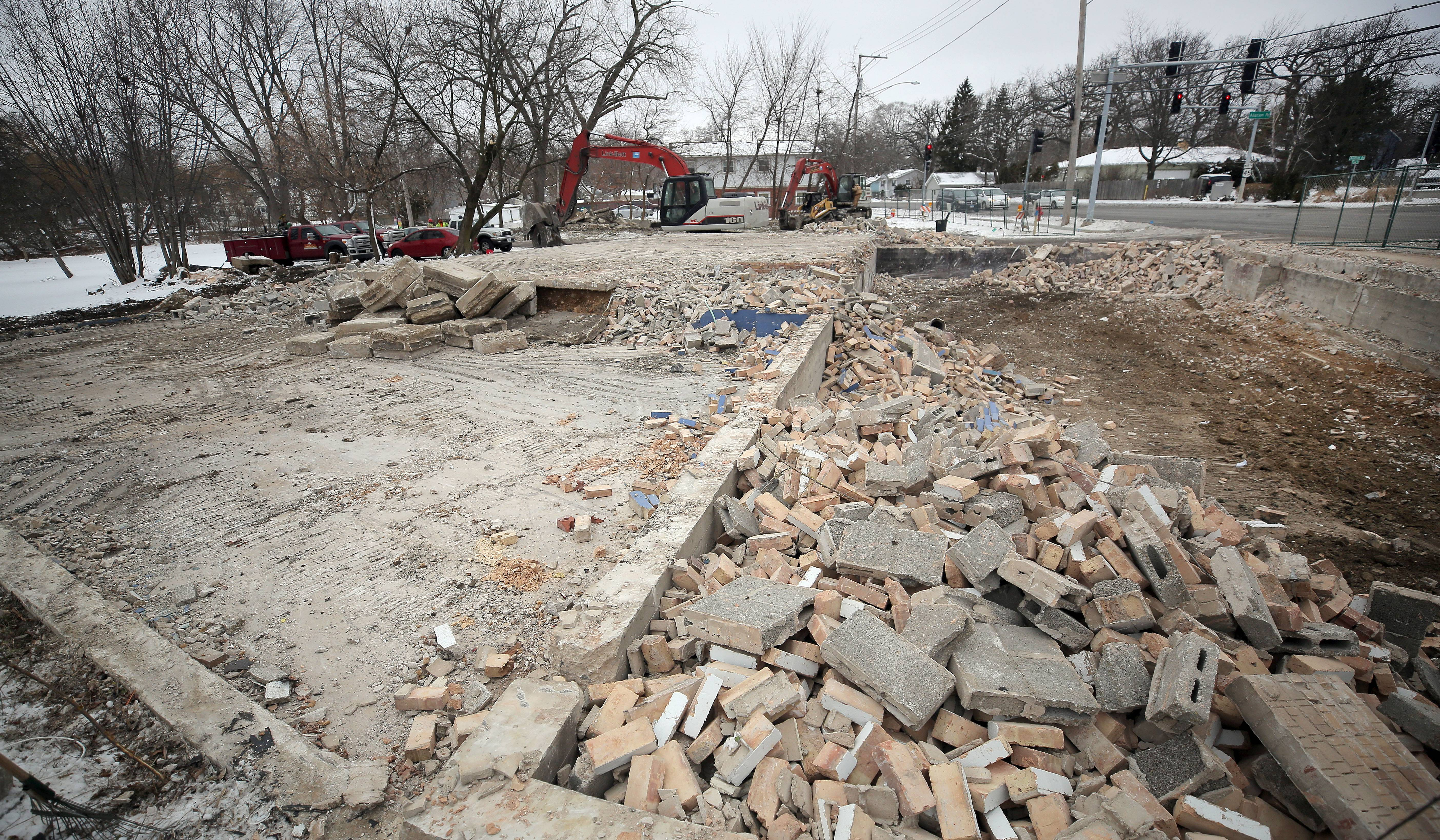 Demolition of buildings on the 600 block of South Lake Street in Mundelein continued Tuesday. The village plans to build a park there and on the land to the north, where Mundelein Apartments now stands.