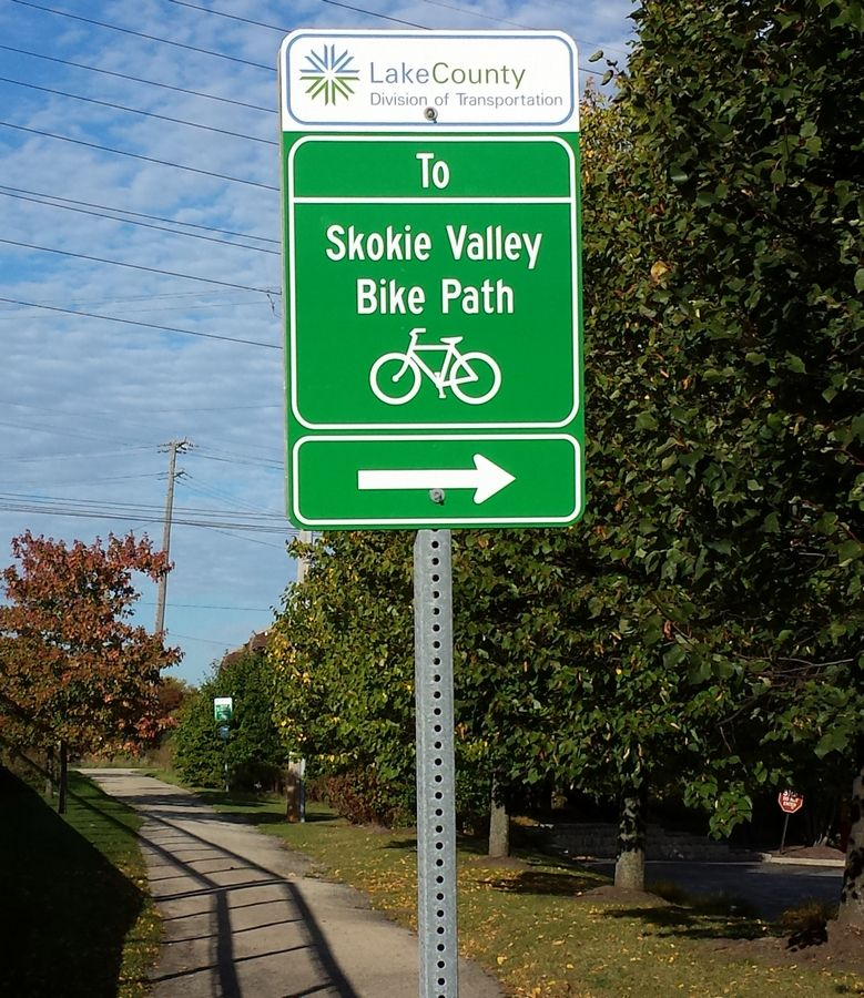 "Signs like this one direct users of county bike paths, but Kevin Carrier of the Lake County Division of Transportation says other agencies have developed ""more robust"" wayfinding systems."