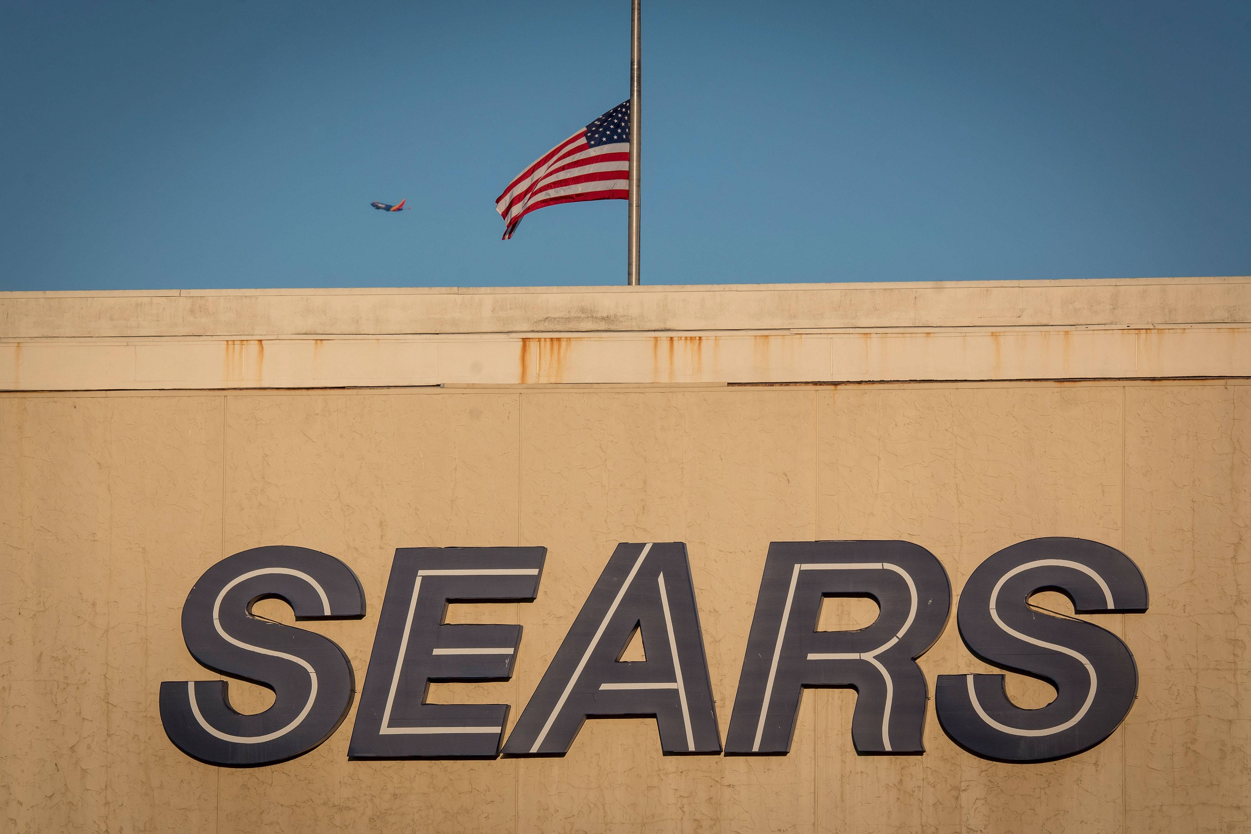 Eddie Lampert won a bankruptcy auction for Sears with a plan that will keep the bankrupt retailer in business and seek to save tens of thousands of jobs, according to a person with knowledge of the discussions.