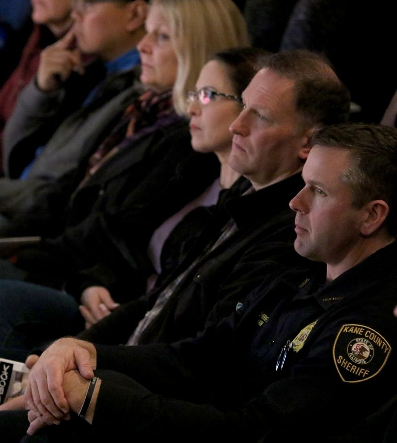 "Kane County Sheriff Ron Hain, right, listens during the ""Wake Up Call"" program at Geneva High School Tuesday evening. The program is designed to educate parents and caregivers about trends in teen drug use and how to detect the methods teens use to hide substance use."