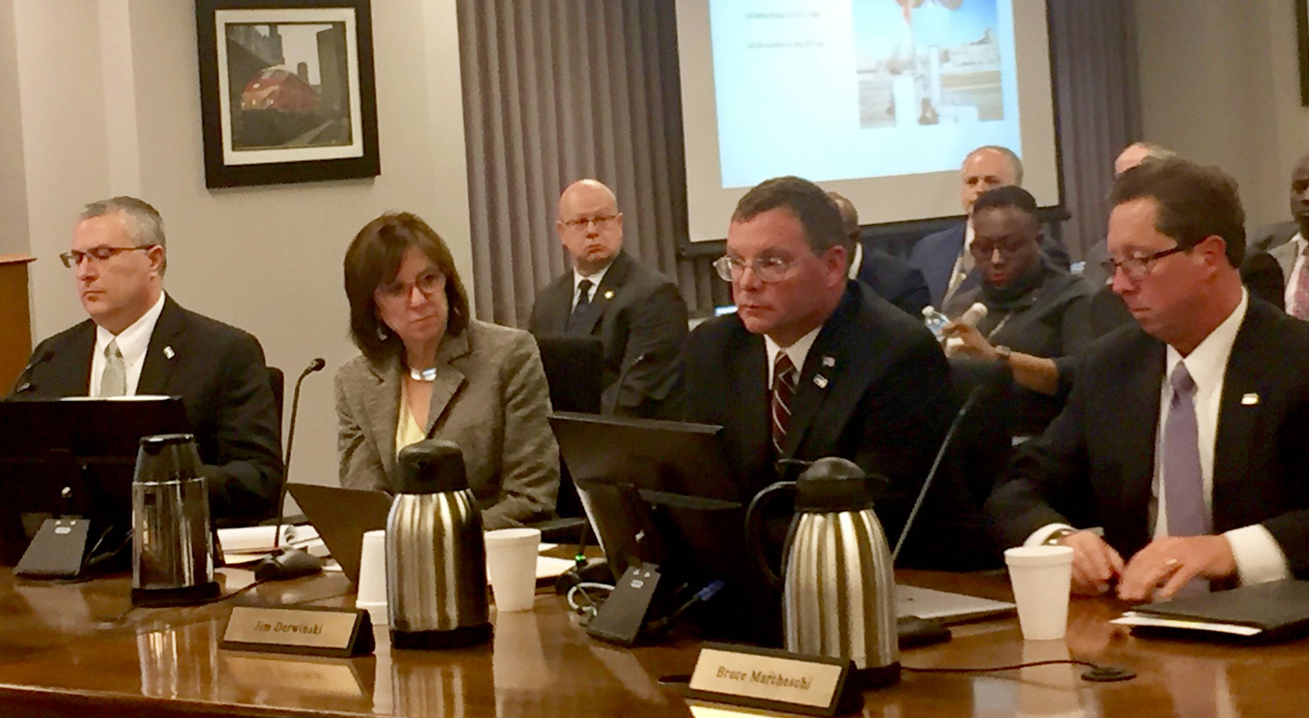 Metra Executive Director Jim Derwinski, second from right, briefs board directors Wednesday about two near-misses.