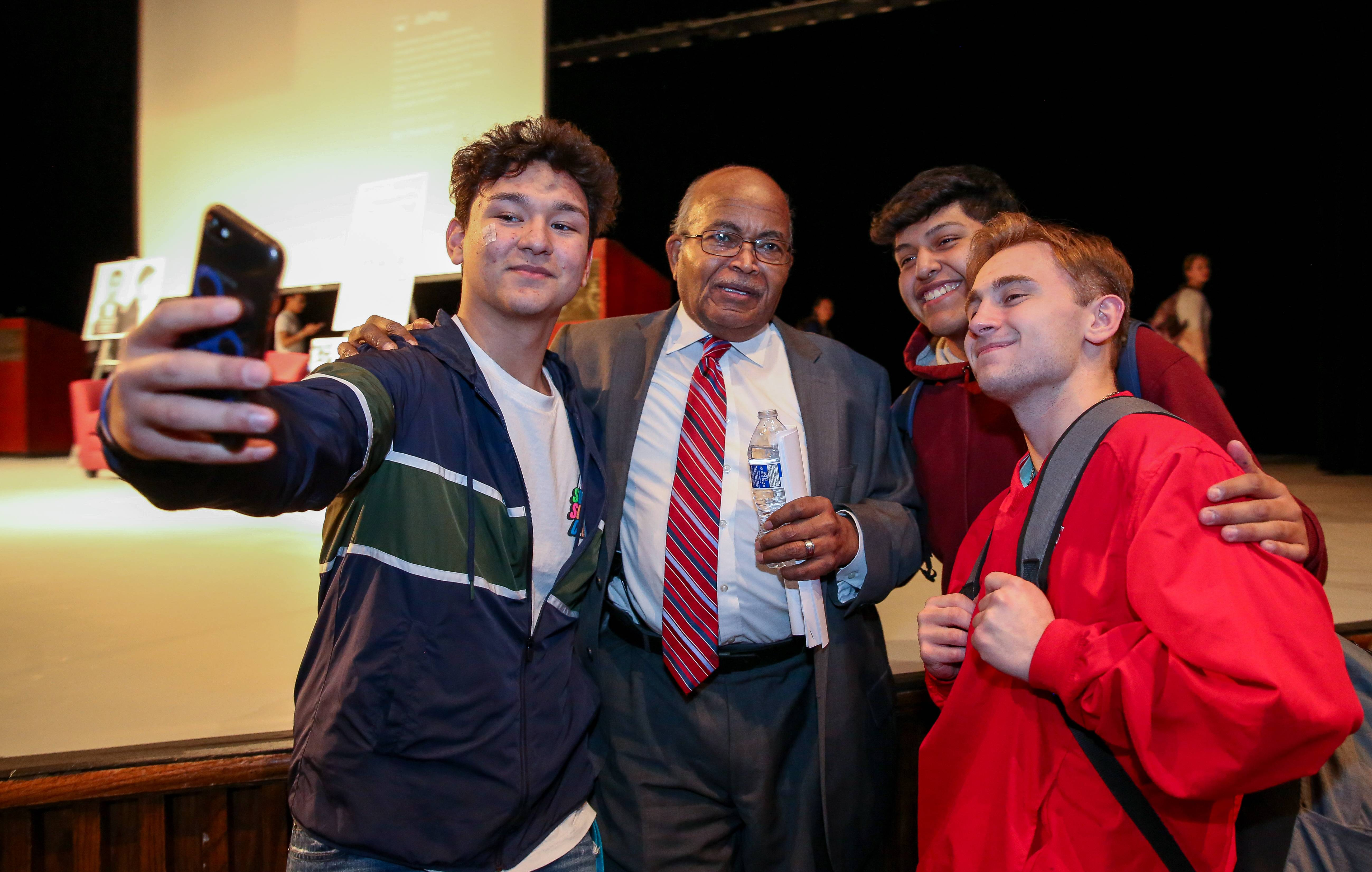 Thomas Armstrong of Naperville poses with, from left, Buffalo Grove High School juniors Giovanni Alegria, Juan Simon and Dylan Konefes after speaking at the school Wednesday about his role in the civil rights movement as a Freedom Rider.