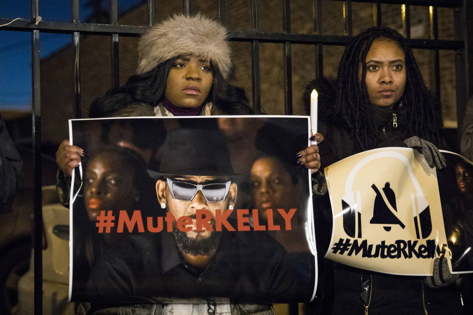 "#MuteRKelly supporters protest outside R. Kelly's studio in Chicago. Lifetime's ""Surviving R. Kelly"" series, which aired earlier this month, looks at the singer's history and allegations that he has sexually abused women and girls. Kelly, 52, has denied wrongdoing."