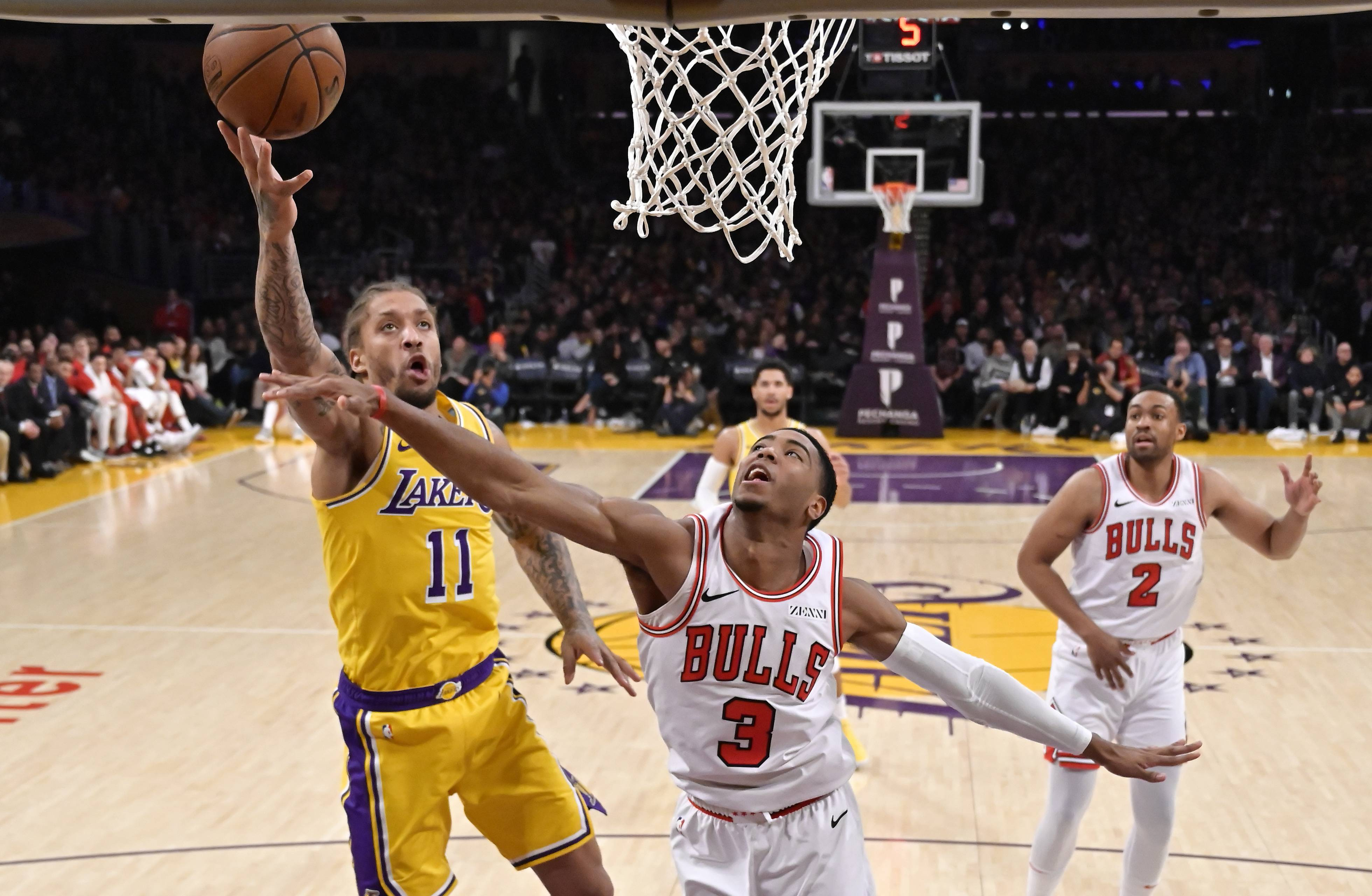 Los Angeles Lakers forward Michael Beasley, left, shoots as Bulls guard Shaquille Harrison, center, defends and Jabari Parker looks on during Tuesday's loss. Parker was back in the rotation for Tuesday's 107-100 loss to the Los Angeles Lakers, and Robin Lopez was out. Things could change again for the Bulls, though, since Wendell Carter injured his left thumb in the game.